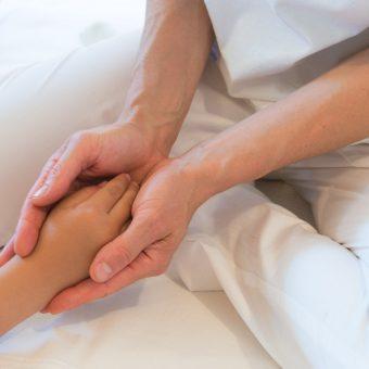 Shiatsuberührung Kinderhand